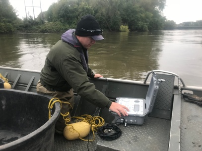 Michael Vaske, Minnesota River Specialist, checking for pings from acoustic tags